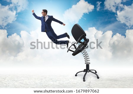 Photo of  Promotion concept with businessman ejected from chair