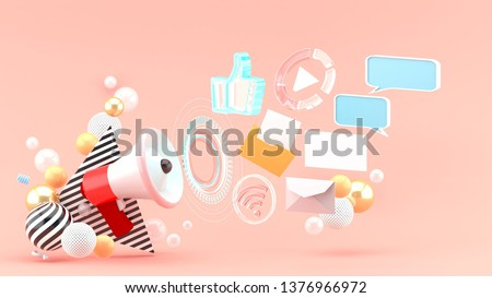 Promotion megaphone surrounded by work files, letters, messages and pictures among colorful balls on a pink background.-3d rendering.