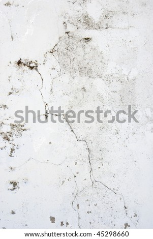 Pronounced cracks in a wall with extra textures - stock photo