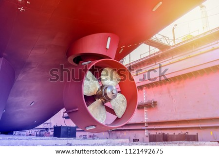 Propeller during to repair already of big Cargo ship Stern Bow thruster freshly fitted in a boat hull at floating dock in shipyard Thailand