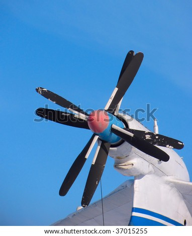 Propeller of plane against the background of blue sky