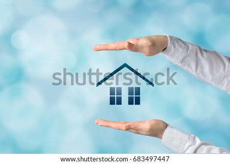 Property insurance concept. Home insurance and security concept. Protecting gesture of businessman and symbol of house and business background.  #683497447