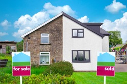 Property Sales UK. Estate Agents For Sale and Sold Signs on semi detached Houses. Visual to show benefits of property maintenance for house sales. Contrast of run down versus well maintained property