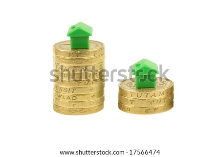 Property stock market crash, pound coins, houses, isolated on a white background