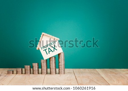 Property Tax Concept-House shape on stacked coins