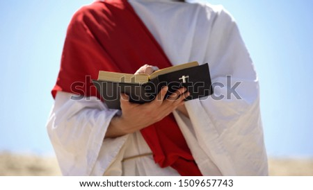 Prophet in robe reading bible, theology and interpretation of Christianity #1509657743