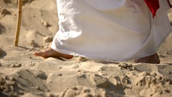Prophet legs walking on sand, following of Jesus faith, religious conversion