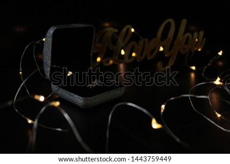 Proposing ring on the dark background #1443759449