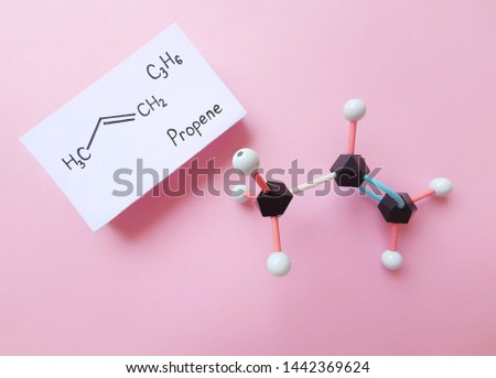 Propylene (Propene or methyl ethylene) is an unsaturated organic compound. Molecular structure model and structural chemical  formula of propene molecule. Black=C, white=H.