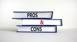 Pros and cons symbol. Books with words 'Pros and cons'. Beautiful white background. Business, pros and cons concept, copy space.