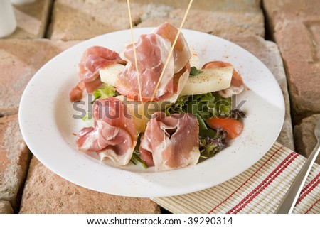Prosciutto ham with salad decoration canape stock photo for Prosciutto and melon canape