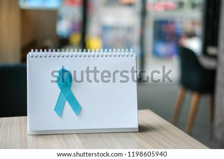 Prostate Cancer Awareness month (November), light Blue Ribbon on white paper for supporting people living and illness. Men Healthcare and World cancer day concept with copy space for your text