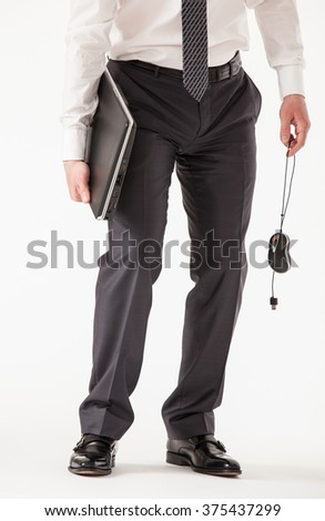 Prostrate businessman holding a notebook and a mouse, white background