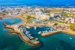 Protaras. Cyprus. Harbor Paralimni. Panorama of Kalamis beach. Bay in the city of Protaras. The beaches of Protaras. Resorts of Cyprus. Yacht parking lot. Cruises in the Mediterranean Sea. Coast