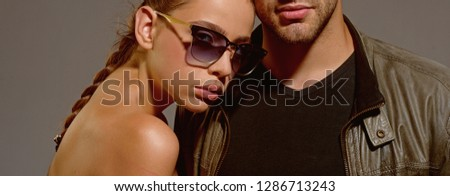 Protect your eyesight. Fashion models in trendy sun glasses. Couple in love. Couple of man and woman wear fashion glasses. Love relations. Friendship day. Friendship relations. #1286713243