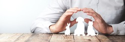 Protecting Hands Over Paper Animals On Wooden Table - Pet Care And Insurance Concept