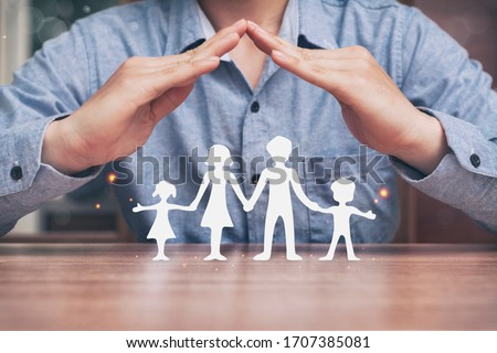 Protecting hands over paper family, family Protection and stay home or working at home with care concept Foto stock ©