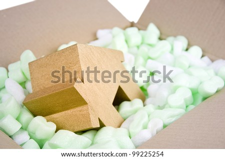 protecting your property, moving house, gold house in box full of foam protective packaging