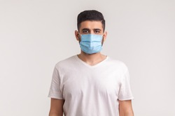 Protection against contagious disease, coronavirus. Man wearing hygienic mask to prevent infection, airborne respiratory illness such as flu, 2019-nCoV. indoor studio shot isolated on white background