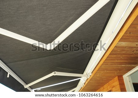 Shutterstock Protection Against Sun and Heat. Sun Protection Patio Awning . Outdoor Patio Sun Shade Awning.  Wooden Patio Garden Umbrella Sun Shade Outdoor.