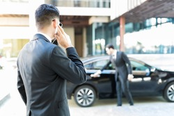 Protection agent in suit getting constant updates through earpiece to avoid danger