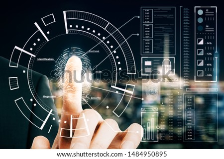 Protection and security concept with man finger pushed on digital screen with fingerprint anf cyberspace icons.
