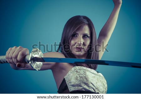 Stock Photo Protection.Anime stylized brunette with short hair holding a katana sword with two hands