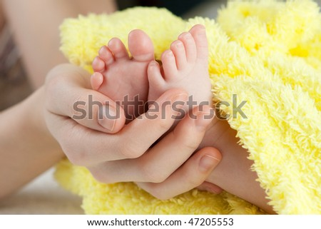 protection. babyâ??s feet in mommy's hand