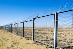 protection fence with barbed wire