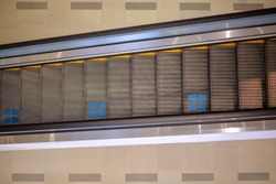 Protection measures in the department store. footprint sign blue color on the escalator floor for the Standing. Social distancing with COVID-19 corona virus crisis.Location or distance concept.