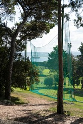 protection net in a golf field to practice or golf netting or  golf shooting net