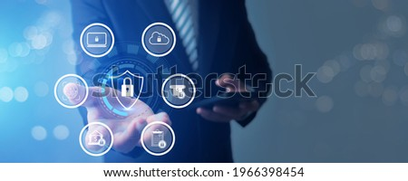 Protection network security computer data and safe  financial stability Businessman holding shield protect icon to protect digital business finance bank and high private safe technology Foto stock ©