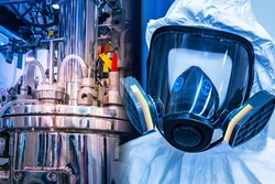 Protective chemical suit. Chemical protection suit against the background of the laboratory. Conducting experiments with dangerous substances. Protective equipment for chemists.