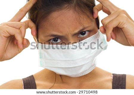 protective face mask on an attractive young Asian woman, isolated on white