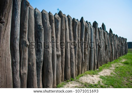 protective fence made of logs...