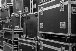 Protective flight cases on backstage zone. Storage with empty flight cases from professional concert equipment.