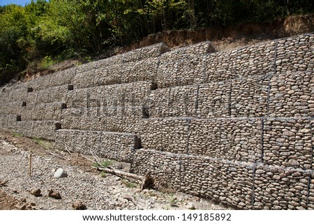 Protective gabion wall in mountains