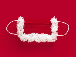 protective mask for Santa Claus, red and white on a red background