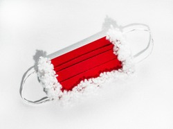 protective mask for Santa Claus, red and white on a white background with hard shadows