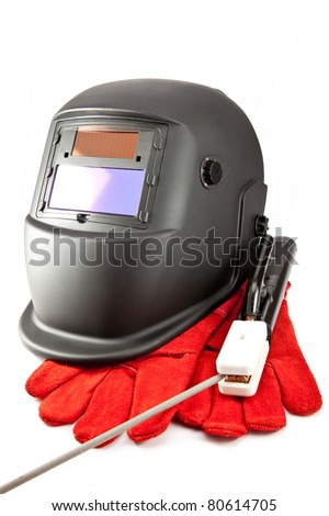 Protective mask of the welder, electrode and gloves on a white background