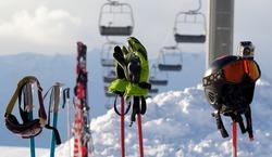 Protective sports equipment on ski poles at ski resort at sunny evening