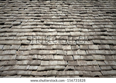 Protective wooden shingle on the roof.