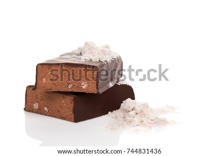 Protein bar and powder isolated on white background.