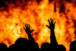 Protest fire, hands raised in unity