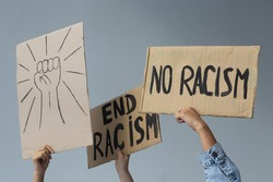 protest white and black hands holding cardboard poster with message text END RACISM on white background. Concept on the theme of prostate in minneapolis and police aggression of racism.