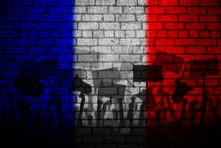 Protests in France. Silhouette of group of people protesting with a flag of France as a background