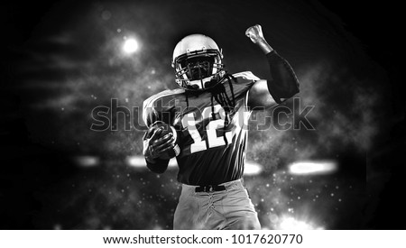 Proud american football player in dark