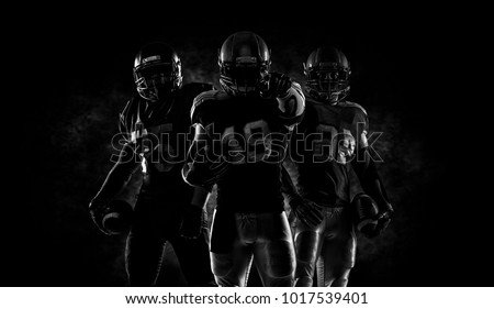 Proud american football players in dark #1017539401