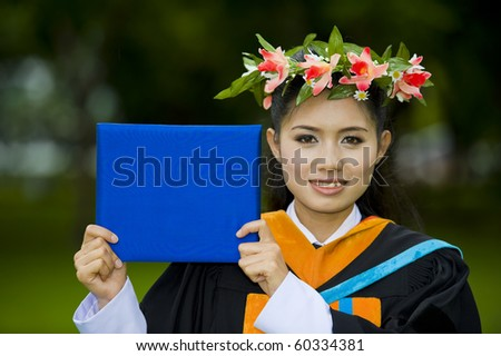proud asian student showing on her graduation day
