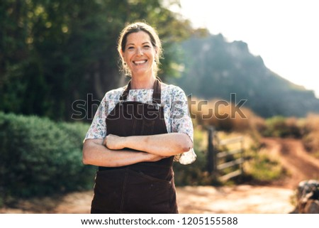 Proud farmer at her countryside home